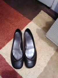 pair of brown leather flat shoes