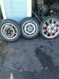 three grey motorcycle wheels and tires Cleveland, 44120