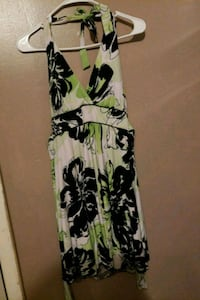 white, green, and black floral sleeveless dress