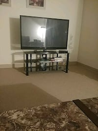 black flat screen TV with black wooden TV stand Regina, S4S 6X7