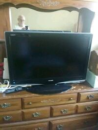 black flat screen TV with remote Loveland, 80537