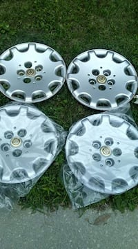 new 4 hubs cover 15'' for a town and country  Hanover