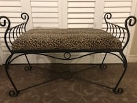 black metal framed brown fabric padded bench