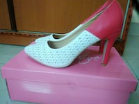 pair of pink-and-white pumps Bengaluru, 560068