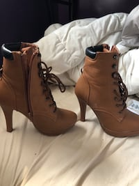 Pair of brown leather boots Winnipeg, R2L 0A9