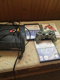 black Sony PS3 Slim with controllers and game cases 863 mi