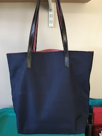 New canvas tote with red gingham lining.  Has zippers and pockets inside. Leland, 28451