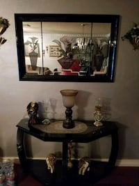 black table with glass top and matching mirror. San Antonio, 78251