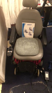 black and red motorized wheelchair