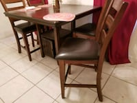 brown wooden table with chairs Sarasota, 34234