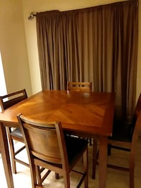 Solid wood brown dining room table Mentone