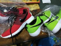 two pairs of green and red Nike running shoes