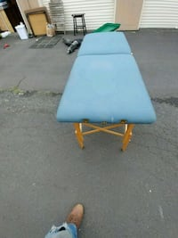 Black and blue massage table