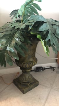 Faux silk plant, great light weight vase stands 32 tall