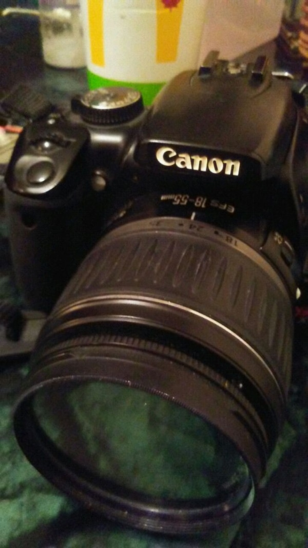 Black and gray Canon EOS DSLR camera