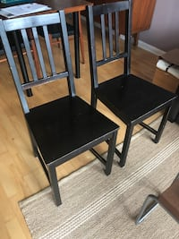 Four black wooden armless chairs (Stefan from Ikea) 535 km