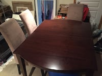 Excellent expandable dinning room suite with chairs Surrey, V4P 1L5