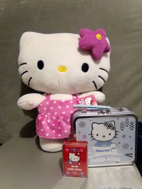 Hello Kitty lunchbox, plush toy, and miniature deck of playing cards e5bdf148-cdcf-4221-b621-5e0dad71d477