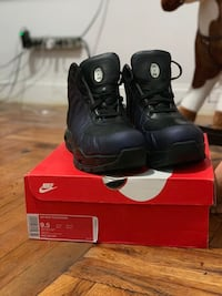 pair of black leather boots 228 mi
