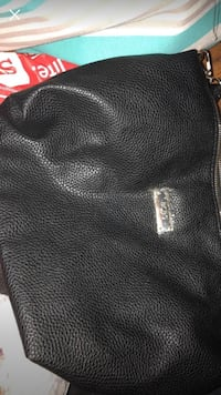 Black leather purse. Never been used. Perfect condition  Tulsa, 74112