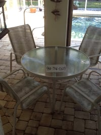 round glass top table with four chairs Punta Gorda, 33983