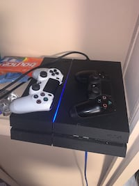 PS4 w/ two controllers, hdmi, and power cord.