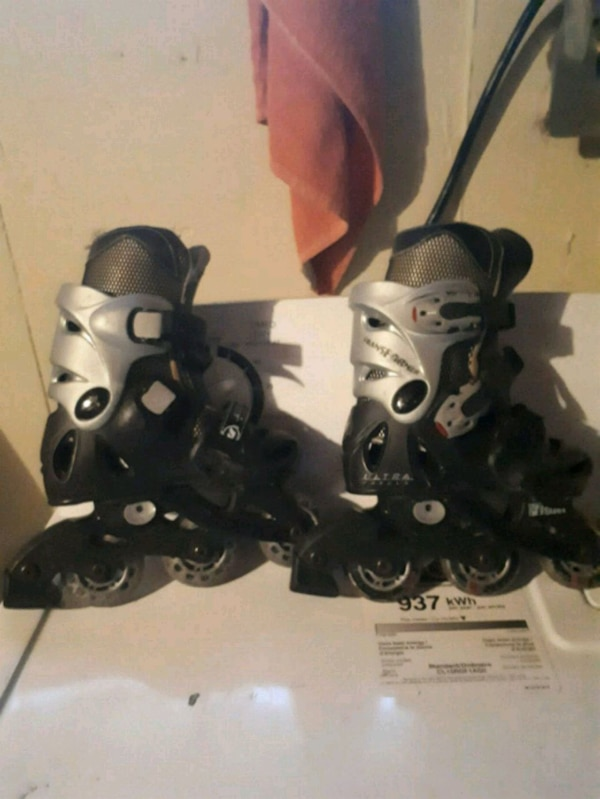 pair of black inline skates