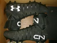 pair of black Under Armour cleats El Paso, 79936