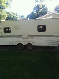 white and gray RV trailer Ames