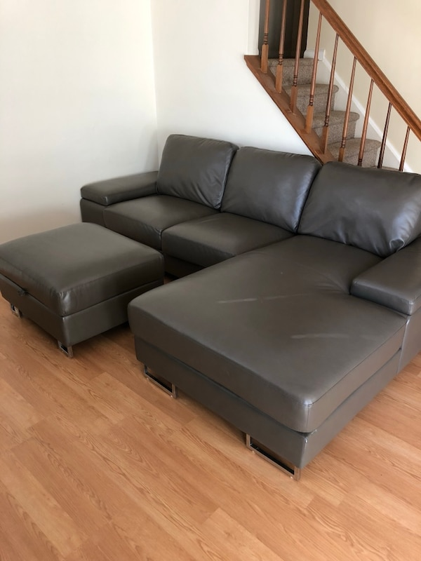 Grey leather sectional sofa with ottoman