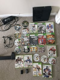 Xbox 360e with lots of games and 2 batterie packs for wireless controllers, and all cords needed, but the console need some cleaning for the disk tray McLean