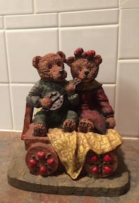 Bear couple sitting in wagon - collectible