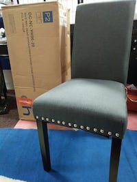 gray and black fabric padded armless chair and rectangular brown cardboard box