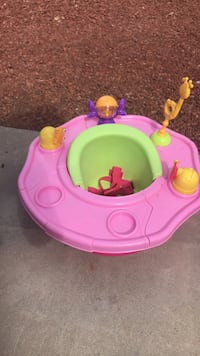 baby's pink and green activity saucer El Paso, 79936