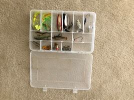 Tackle box and fishing lures.