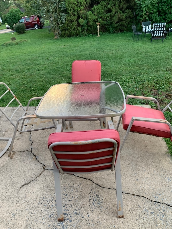 Patio table and 4 chairs (cushions sold, just table and chair now) 05fbe7e9-0e56-4d52-a14f-6c0deef0146f