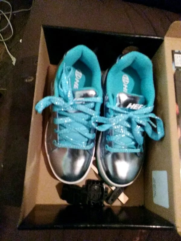 pair of blue-and-black sneakers afd71bd2-59b4-47a5-95e2-e5526945a974