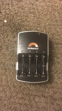black and brown Duracell battery charger