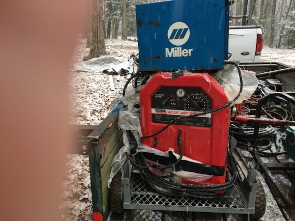 red and black Welding machine and blue Miller Tig high frequency unit