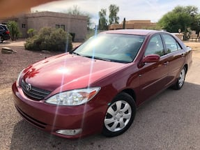Toyota Camry with 189k Miles. Runs perfect just passed emissions.