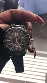 round black chronograph watch with link bracelet Los Angeles, 91601