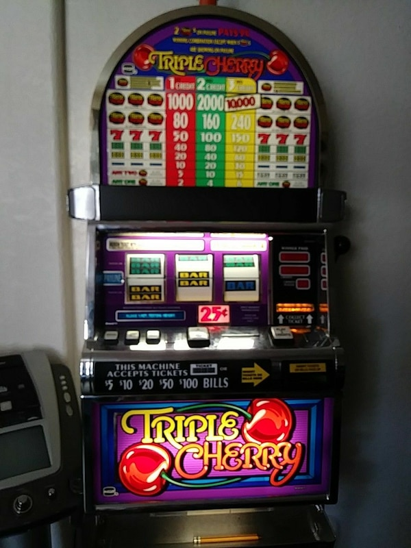 grey and multicolored Triple Cherry slot machine