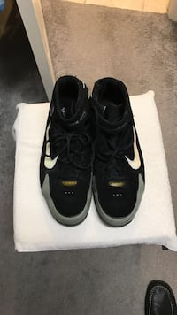 Pair of black nike low-top sneakers