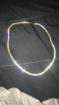 Gold-colored tennis necklace