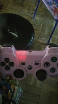 pink and black Sony PS3 controller Antelope, 95843