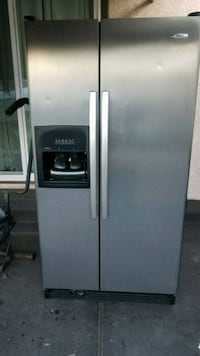 gray side-by-side refrigerator with dispenser 2276 mi