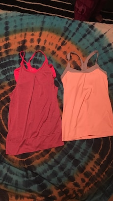 two women's red and orange workout tank tops