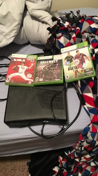 Black xbox 360 game console with game cases. does include a working controller . Fargo, 58102