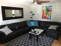 Black leather sectional couch with throw pillows Calgary, T2G 3H2
