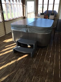 gray hot tub with gray step ladder